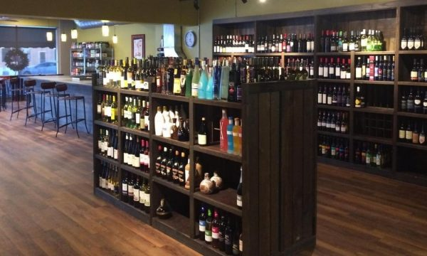 Wine bottles on shelves in Mustards wine shop and bistro